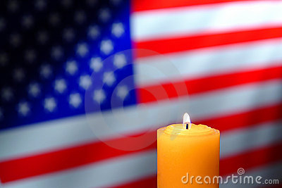US American Flag and Commemorative Candle Burning