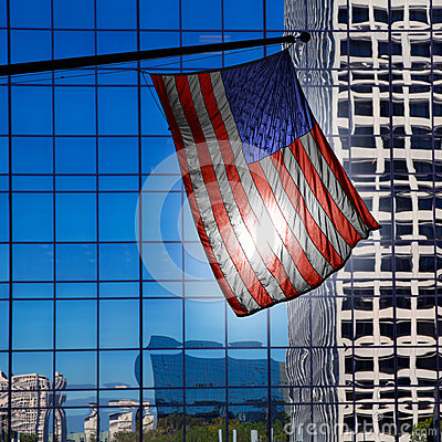 US american symbol flag over blue modern LA buildings