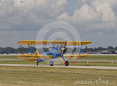 US Army Bi Plane Fighter starting on runway Editorial Stock Photo