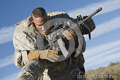 US Army Soldier Carrying Wounded Colleague
