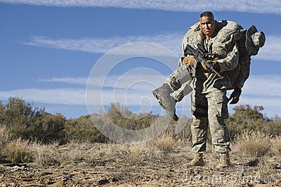 US Army Soldier Carrying Wounded Friend