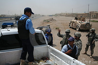 US Army Soldiers check Iaqi Police at Checkpoint Editorial Stock Photo