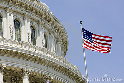 US Capitol dome detail with flag