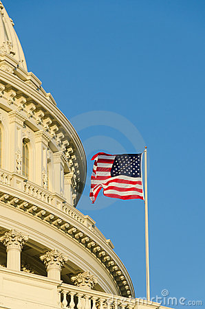 US Capitol dome detail with US flag on flagpole -