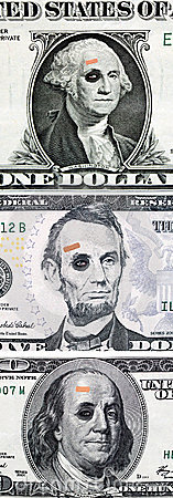 US currency with black eyes