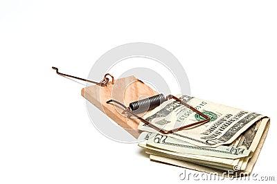 US Dollar Bills in Mousetrap