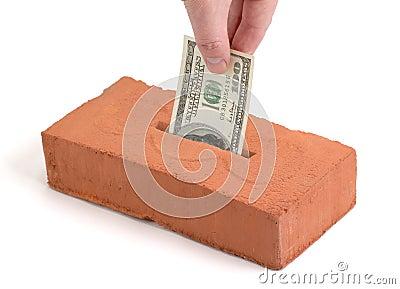 US Dollar deposit into a building brick