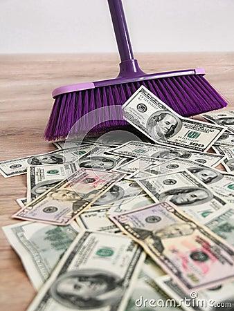 US dollars and broom Stock Photo
