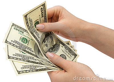 US Dollars in woman s hand, isolated with clipping