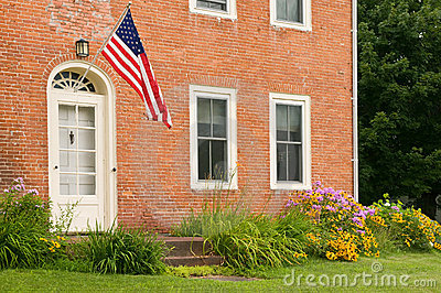 US Flag on old brick house