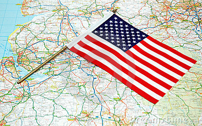 US flag over map
