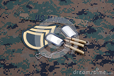 US  Marines concept with service tapes, dog tags and camouflaged uniform