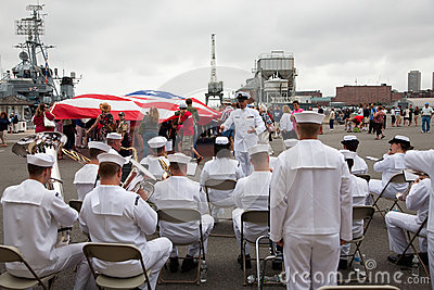 US Navy Band plays in front of US Flag