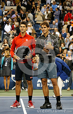US Open 2013 champion Rafael Nadal and finalist  Novak Djokovic during trophy presentation after final match Editorial Photo