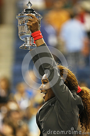 US Open 2013 champion Serena Williams holding US Open trophy after her final match win  against Victoria Azarenka Editorial Stock Image