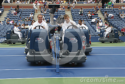 US Open cleaning crew drying tennis court after rain delay at Arthur Ashe Stadium Editorial Image