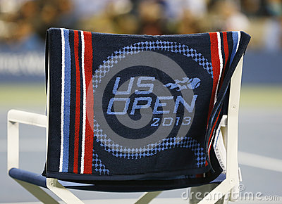 US Open 2013 official towel on player chair at the Arthur Ashe Stadium Editorial Stock Image