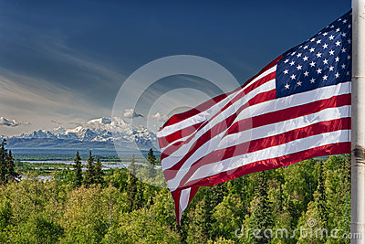 Usa American flag stars and stripes on mount McKinley Alaska background