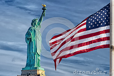 Usa American flag stars and stripes on statue of liberty blue sky background