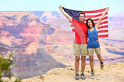 USA travel tourist couple holding american flag