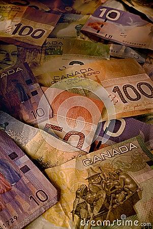 Used Canadian Dollar Bills in Warm Light