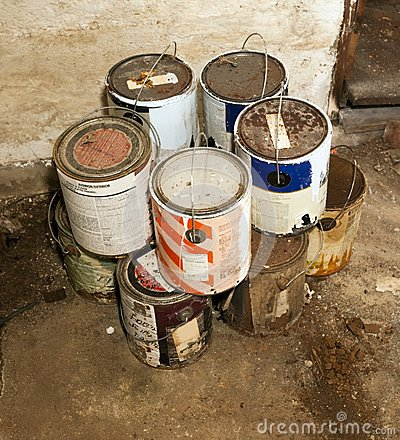 Free Used Paint Cans Stacked On Basement Floor Stock Photography - 117662572