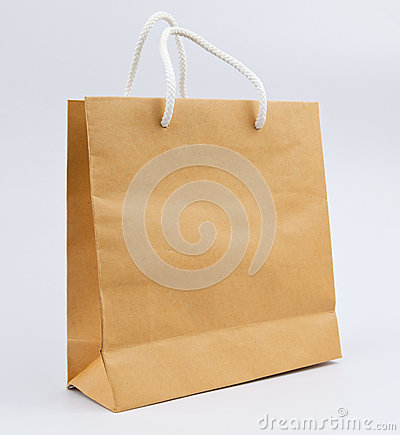 Used paper bag white rope on gray background