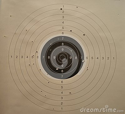 Used shooting paper target with bullet holes