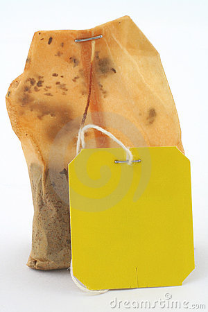 Used tea bag with an empty tag