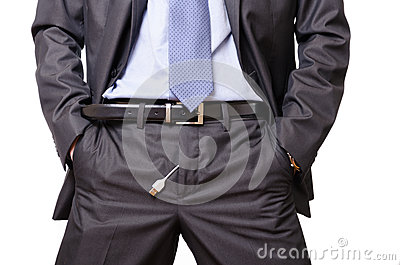 Usinessman pulls out a usb cable off his pants.