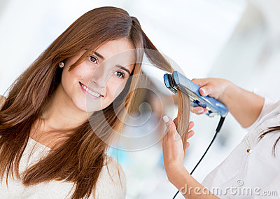 Using a hair straightener at the salon