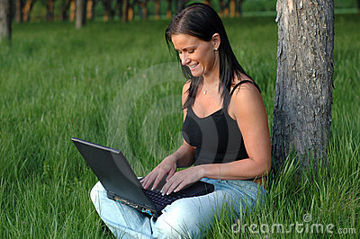 Using laptop in the park
