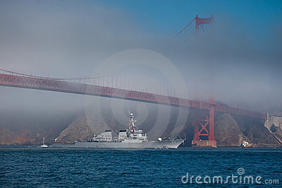 USS Milius glides under Golden Gate Bridge Editorial Image