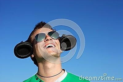 Сute blond in glasses with headphones