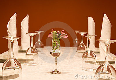 Utensils - wine-glasses and plates on a table
