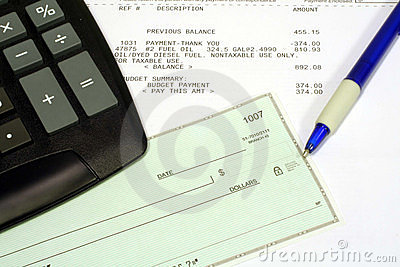Utility Bill, Personal Check and Calculator