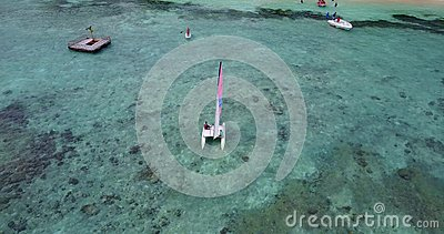 V09339 People enjoying boats and watersports with view from aerial flying drone in clear aqua blue sea water and blue Stock Photo