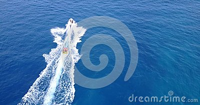 V09366 People enjoying boats and watersports with view from aerial flying drone in clear aqua blue sea water and blue Stock Photo