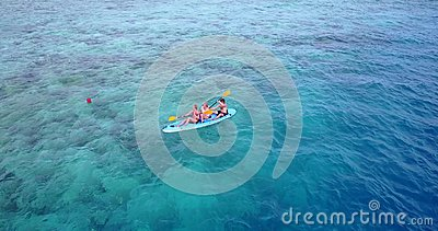 V09389 People enjoying boats and watersports with view from aerial flying drone in clear aqua blue sea water and blue Stock Photo