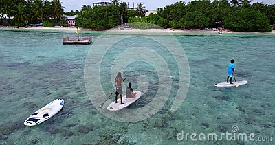 V09325 People enjoying boats and watersports with view from aerial flying drone in clear aqua blue sea water and blue Stock Photo