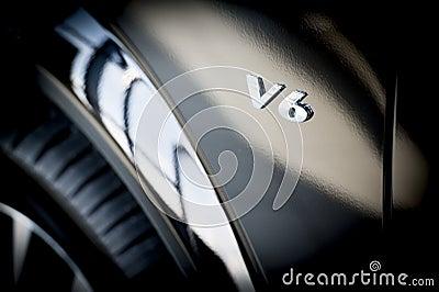 V6 Emblem on side of new car