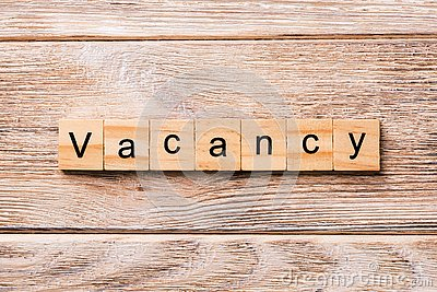 Vacancy word written on wood block. Vacancy text on wooden table for your desing, concept Stock Photo