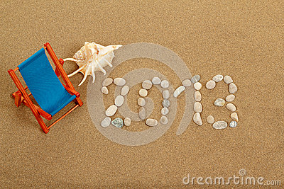 Vacation background with sun lounger and text 2013 from stones