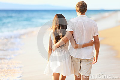 Vacation Couple Walking on Beach