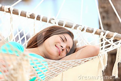 Vacation woman in hammock sleeping