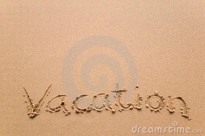 Vacation written in sand