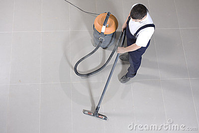 Vacuuming floor with cleaning machine