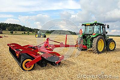 Vaderstad cultivator and John Deere Tractor Editorial Stock Photo