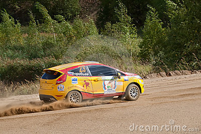Vadim Zhenov drives a yellow Ford Fiesta Editorial Stock Image