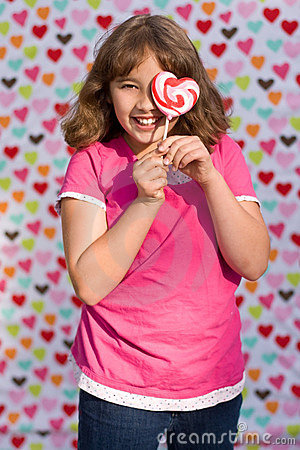 Valentine girl with lollipop